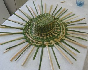weaving a cattail hat